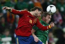 Spain's Sergio Ramos and Ireland's Richard Dunne go for a header during  their Group C Euro 2012 soccer match in Gdansk