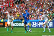 Kolbeinn Sigborsson of Iceland controls the ball under pressure from Zoltan Gera of Hungary and Richard Guzmics of Hungary during the UEFA European Championships 2016 , group F match between Iceland and  Hungary    played at Stadium Velodrome  , Marseille